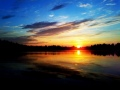 Kalassa auringonnousussa